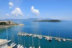 Vidos Island in the Gulf of Corfu and the yacht marina of the Old Fortress of Corfu, Corfu City, Corfu Island, Greece, Europe royalty free stock photography