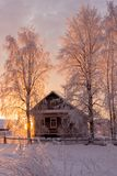 Small, Wooden, beautiful, wooden house at sunset.
