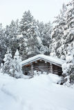 Small wooden blockhouse in the snow Royalty Free Stock Photo