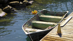Small wooden rowboat with bouquet of flowers Stock Image