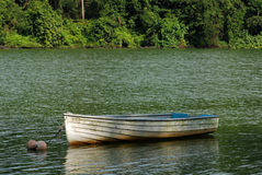 Small wooden boat in the lake Royalty Free Stock Images