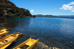 Small wooden boat in the Lugu Lake. Traditional wooden boats floating lugu lake yunnan china Stock Photography