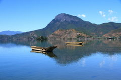 Small wooden boat in the Lugu Lake. Traditional wooden boats floating lugu lake yunnan china Stock Photo