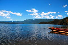 Small wooden boat in the Lugu Lake. Traditional wooden boats floating lugu lake yunnan china Royalty Free Stock Images