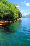 Small wooden boat in the Lugu Lake. Traditional wooden boats floating lugu lake yunnan china Stock Image