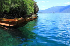 Small wooden boat in the Lugu Lake. Traditional wooden boats floating lugu lake yunnan china Stock Images