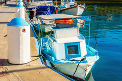 Small wooden boat painted in Greek blue and white Stock Photos