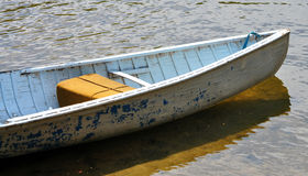 Small wooden boat on the water Stock Photography