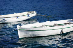 Small wooden boats moored in mediterranean sea marina. Royalty Free Stock Photography