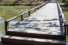 Small wooden bridge across the lake Stock Photo