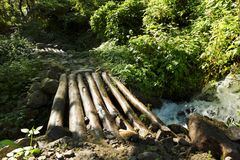 A small wooden bridge across a mountain stream Royalty Free Stock Images