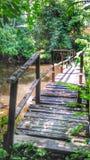Small Wooden bridge cross the small canal Stock Photos