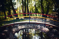 Small Wooden Bridge. Details of colorful small wooden bridge in park during day Royalty Free Stock Image