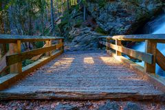 A small, wooden bridge stock images