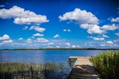 Small wooden bridge on lake Royalty Free Stock Image