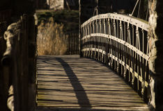 Small wooden bridge. Small wooden bridge with metal handrails stock images