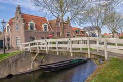 Small wooden bridge over a canal in Medemblik. Netherlands Royalty Free Stock Photography