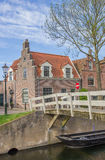 Small wooden bridge over a canal in Medemblik. Netherlands Royalty Free Stock Image