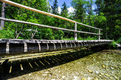 Small wooden bridge over the natural river Stock Photo