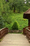 Small wooden bridge. In the park on a background of nature small wooden bridge Stock Photo