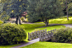 Small wooden bridge in a park Royalty Free Stock Image
