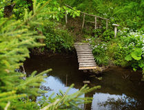 Small wooden bridge and river Stock Image