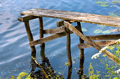 Small wooden bridge in summer day Stock Images