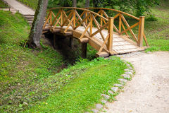 Small wooden bridge and walking lane in park Stock Photos