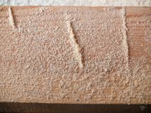 Small wooden chips on beam closeup royalty free stock image