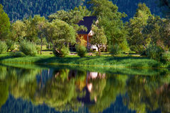 Small wooden bungalow on bank of bay on South part of Lake Telet Stock Image