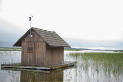 A small wooden cabin on a lake Royalty Free Stock Photo