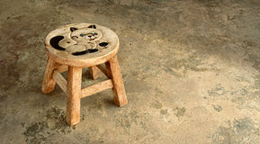 Small wooden chair. Old small wooden chair on old cement floor Royalty Free Stock Photography