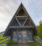 Small wooden chapel in the meadows at sunrise, Giau Pass, Dolomi Stock Image