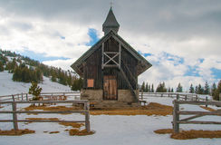 Small wooden chapel. At winter in the Alps Royalty Free Stock Images