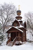 Small wooden chapel in winter time. Snow covered small wooden chapel at the source of St. Sava Storozhevsky in Sergiev Posad, Moscow district, Russia Royalty Free Stock Image