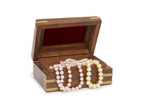 Small wooden chest with pearl necklace Royalty Free Stock Photo