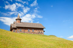 Small wooden church in alps Stock Photo