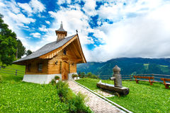 Small wooden church or chapel in Alps mountains. Royalty Free Stock Images