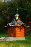 Small wooden church. Stands among spring trees Stock Images
