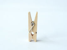 Small wooden clip or wooden clothespins. Close up one of small wooden clip or wooden clothespins  on white background Stock Image