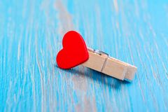Small wooden clothespin with red heart. Valentines day background. Copy space Royalty Free Stock Photo