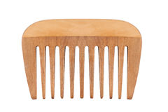 Small wooden comb isolated on white. Front view of children small brown wooden comb with large teeth isolated on white Stock Images