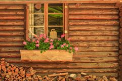 Small wooden cottage with window Stock Photo
