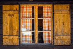 Small wooden cottage with window Royalty Free Stock Images