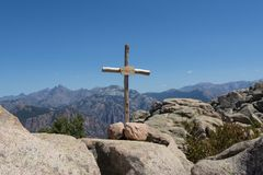 Cross erected on the peak of mountain Stock Photography