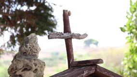 Small wooden cross. With snail on it stock video
