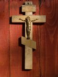 Small wooden crucifix hanging on a wall Stock Image