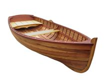Small wooden dinghy isolated. Stock Images