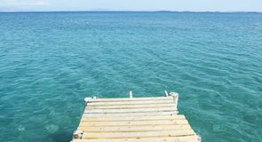 Small wooden dock and blue sea Stock Photo
