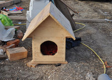 Small Wooden Dog's House on the House Construction Site. Wooden Dog's House on the House Construction Site Royalty Free Stock Photography